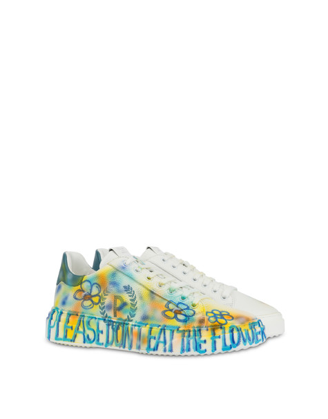 Leather sneakers with 'Please don't eat the flowers' written
