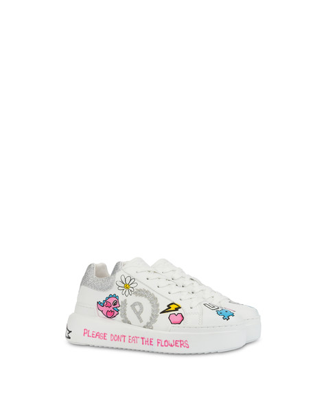 Sneakers with 'Please don't eat the flowers' written
